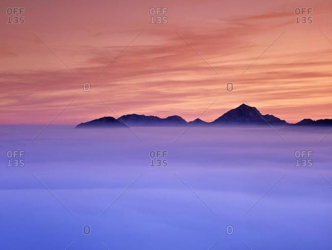 Sunset and fog in the valley Steiner mountain range Carinthia Austria