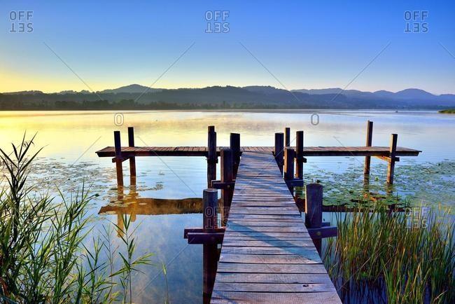 Wooden pier in the morning light at Pfaffikersee, Pfaffikon, canton Zurich, Switzerland, Europe