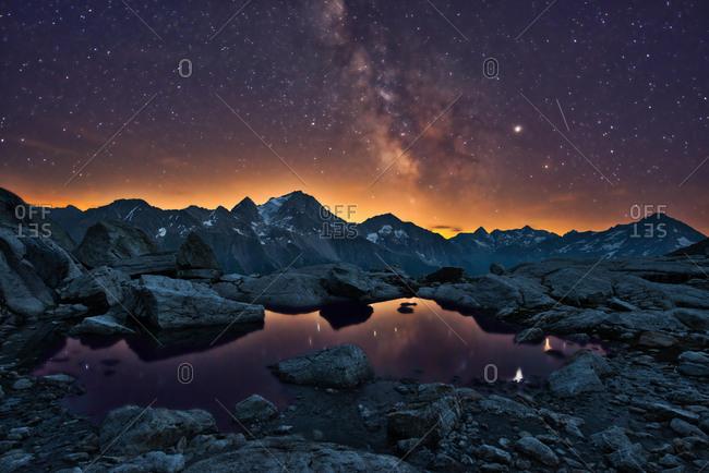 Starry sky with Milky Way, mountains of Uri, Maderanertal, canton Uri, Switzerland, Europe