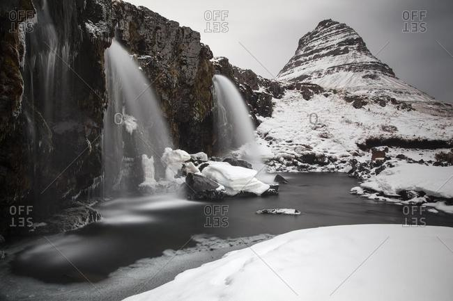Mt Kirkjufell with a waterfall, near Grundarfjorour, Western Region, Iceland, Europe
