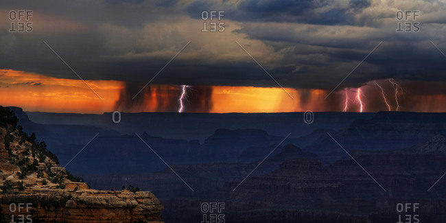 Panorama, Dark thunderclouds with lightning over Grand Canyon at sunset, in front viewpoint Mather Point, South Rim, Grand Canyon, near Tusayan, Arizona, USA, North America