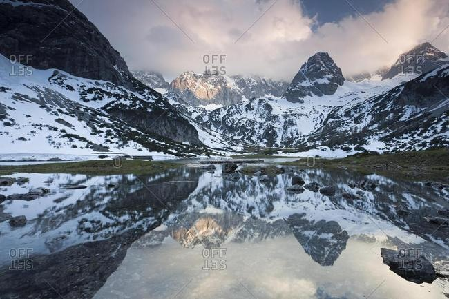 Mountains reflected in Lake Seebensee in Ehrwald in the Austrian Alps, Tyrol, Austria, Europe