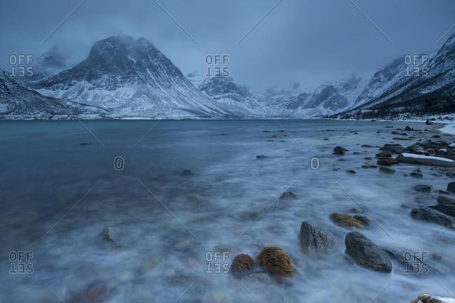 Winter landscape, mountainous coast at Grotfjord, Tromso, Norway, Europe