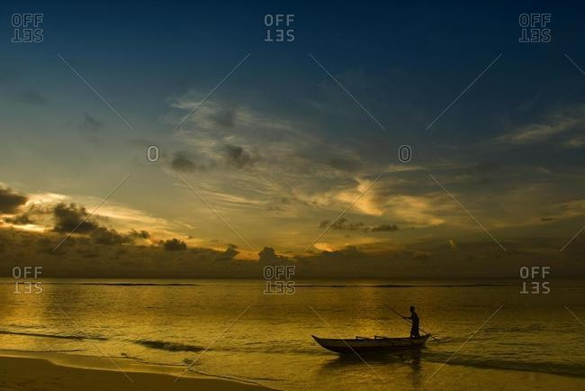 Pirogue on beach, sunset, East Coast, Madagascar, Africa