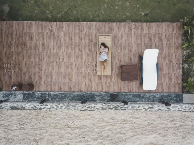 Woman lying on sun lounger,Bali,Indonesia