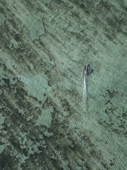 Aerial view of boat with surfboards, Sumbawa, Indonesia