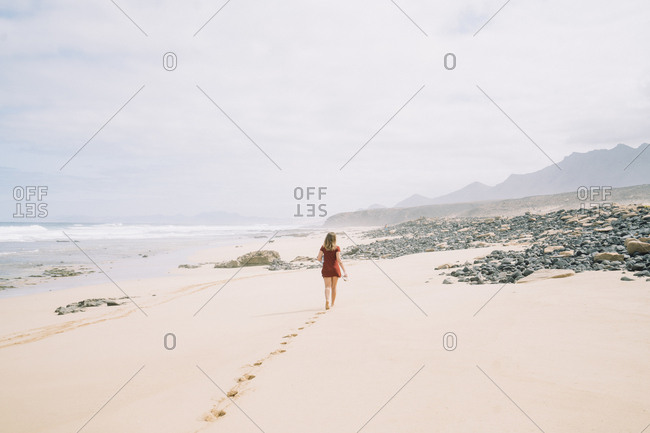 Girl walking in the beach during the day