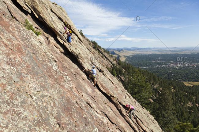 United states, colorado, boulder - august 26, 2018: people rock climb third flatiron east face above boulder, colorado