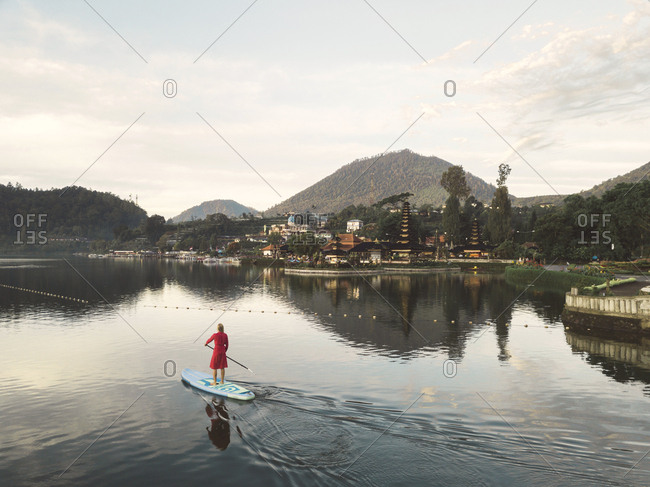 Female sup surfer at bratan lake
