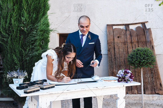 Bride and groom signing bridal book