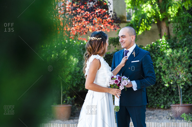 Just married couple looking at each other after wedding ceremony