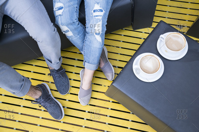 Focus of feet at cafe