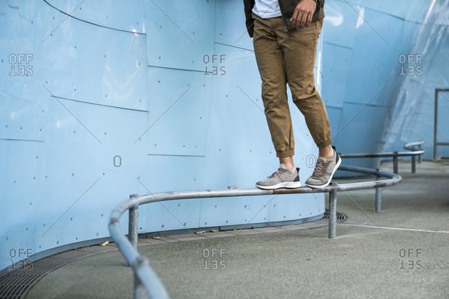 A man balancing on a rail