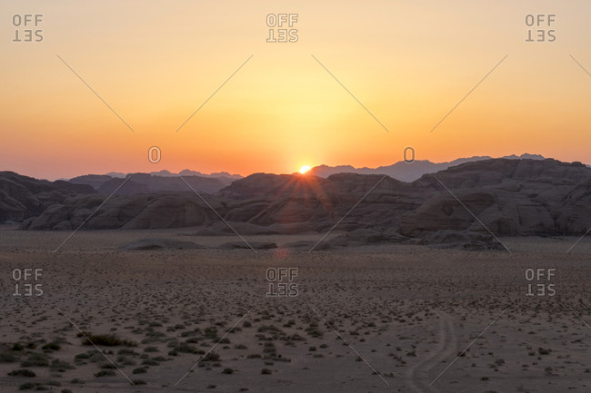 Rock outcrops at sunset in wadi rum protected area, jordan
