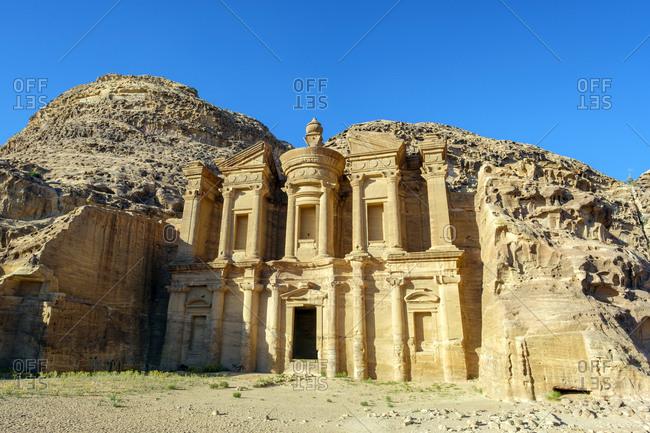 Ad-deir, the monastery carved into sandstone cliff face, petra, jordan