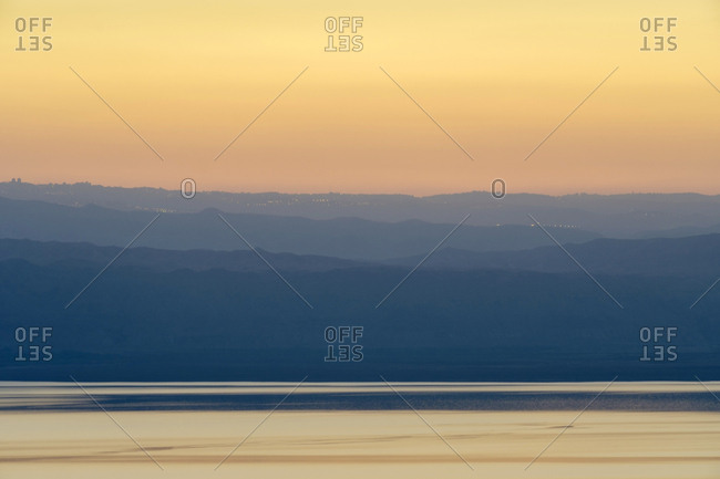 View of dead sea and mountains in israel from jordan at sunset.