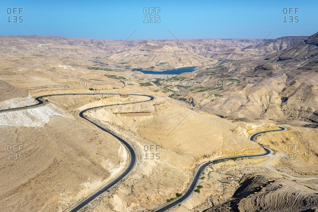 Highway 35 through desert landscape near mujib reservoir, jordan