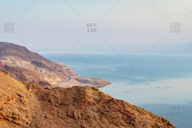 Dead sea coast near ma'in, jordan at sunset