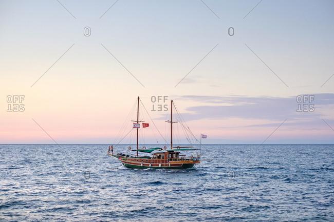 Turkish sailing boat entering kyrenia harbor, kyrenia (girne), cyprus