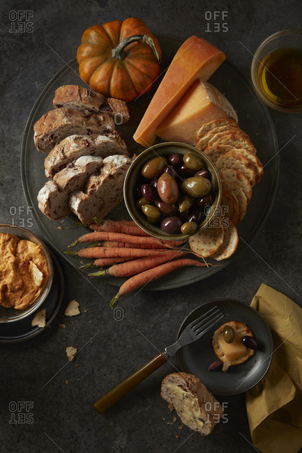 Fall entertaining dish with cheese, crackers, olives, dip and carrots