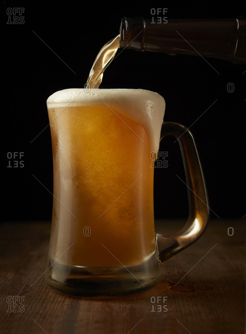 Cold glass of beer poured