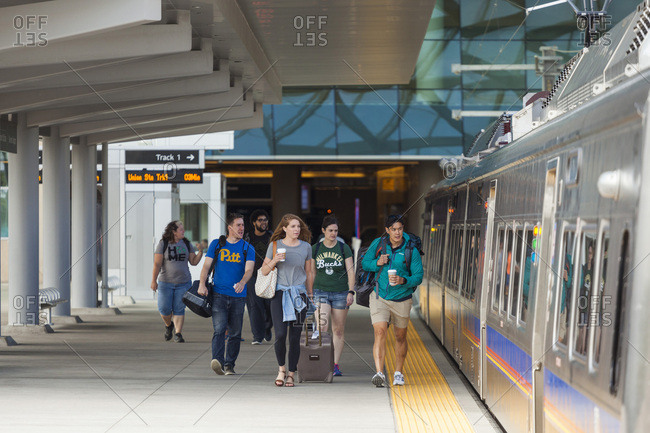 United states, colorado, denver - august 19, 2018: travelers board train at denver international airport station