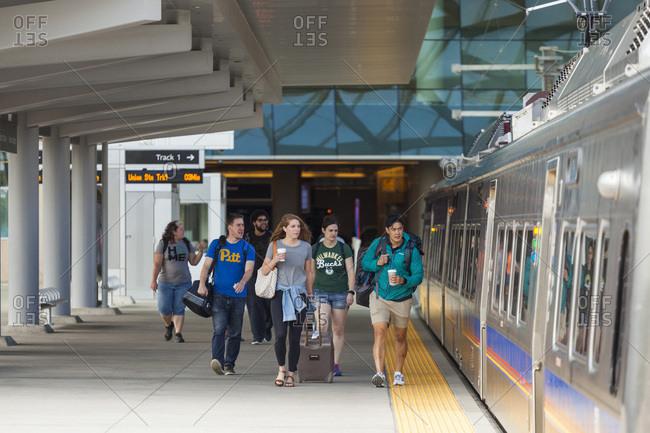 United states, colorado, denver - august 19, 2018: travelers board train at denver international airport station