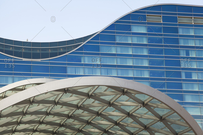 United states, colorado, denver - august 19, 2018: detail of curved glass and steel airport hotel exterior