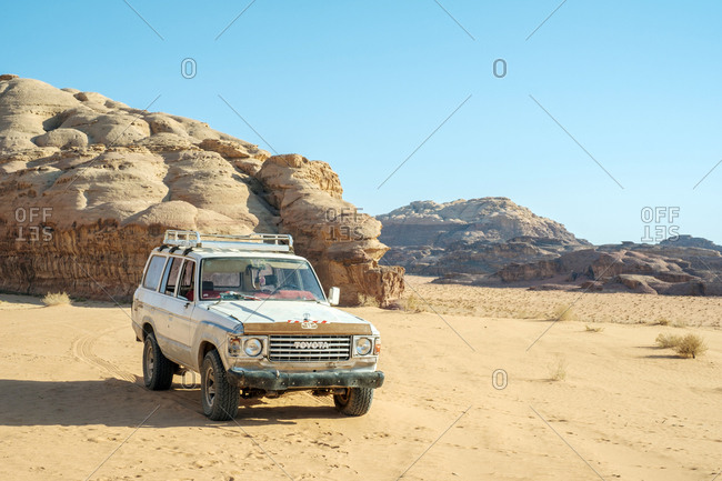 Jordan, aqaba governorate, wadi rum village - june 4, 2017: four-wheel drive truck in wadi rum protected area, jordan