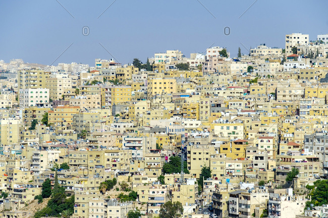 Jordan, amman governorate, amman - june 9, 2017: urban view of buildings in central amman, jordan