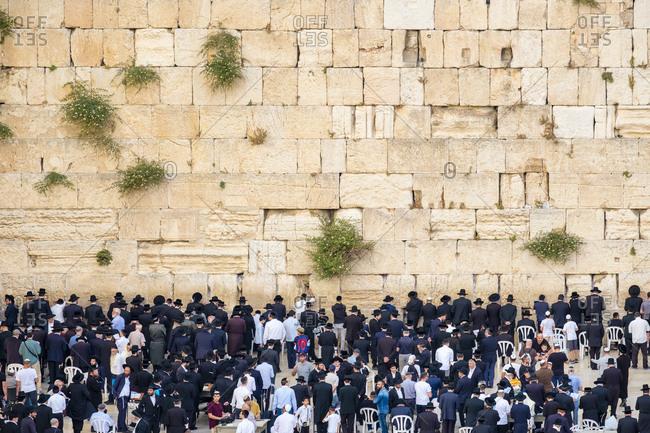 Israel, jerusalem district, jerusalem - may 25, 2017: jewish men praying at the western wall, jerusalem, israel