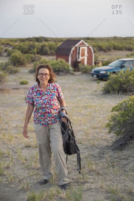 Senior woman poses at campground in desert