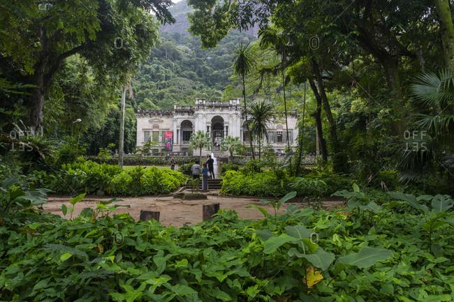Lage Park, Rio de Janeiro, Brazil - August 5, 2019: Beautiful view to big old house in atlantic rainforest landscape