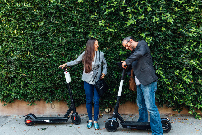 Man and woman with electric scooter