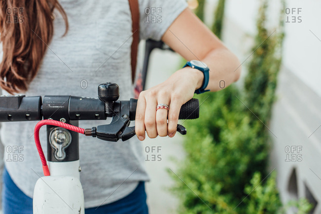 Woman grips scooter