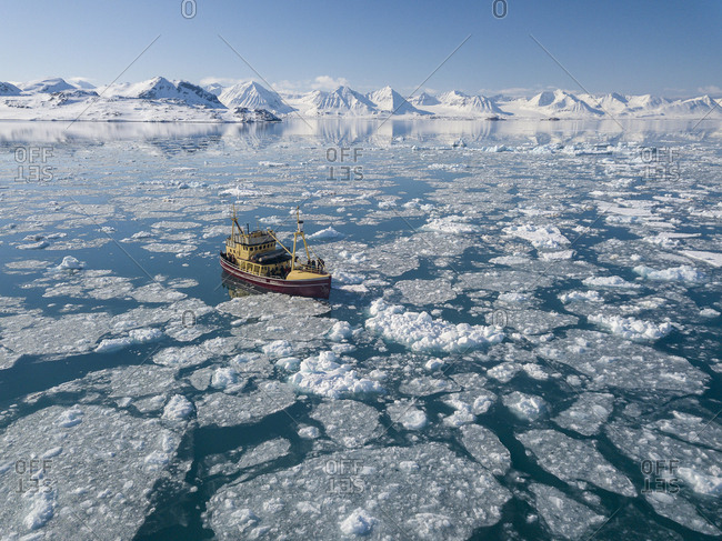 Aerial view of a wooden boat caught in the ice