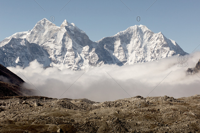 The mountains of the everest region are wrapped in clouds.