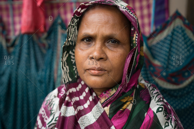 Sylhet, Bangladesh - January 27, 2019: Portrait of a serious bangladeshi woman wearing headscarf in her home