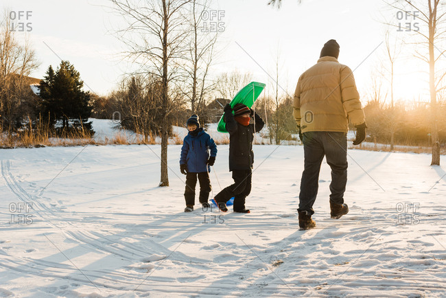 Family sledding outdoors