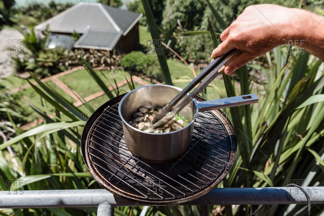 Pot of shellfish being cooked on a balcony grill