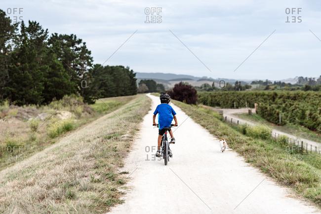 Tween boy riding a bike through the countryside