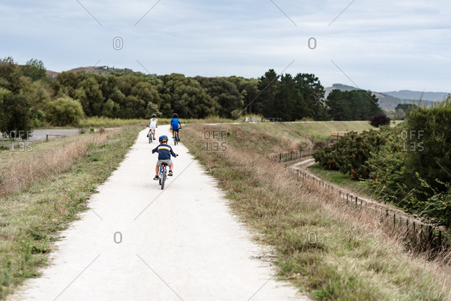 Children riding bicycles on a trail in new zealand