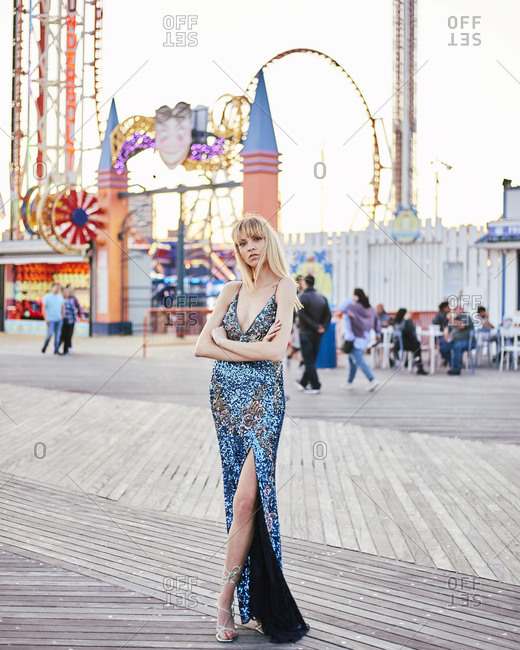 United States, New York - June 14, 2019: Beautiful stylish blonde woman in sequined evening gown on boardwalk