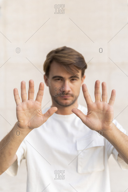 Man raising hands- close-up