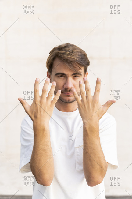 Portrait of man raising hands
