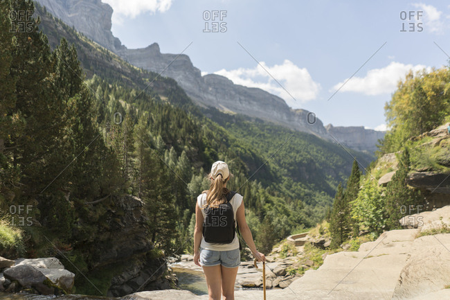 Rear view of woman enjoying the view in the mountains- Ordesa national park- Aragon- Spain