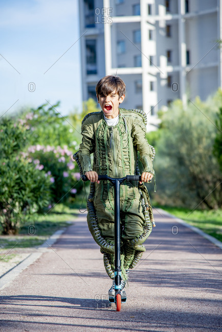 Boy wearing a space suit on scooter