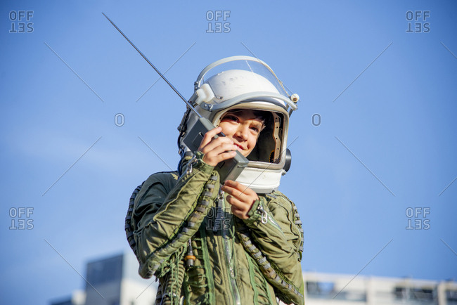 Boy wearing a space suit and using walkie talkie