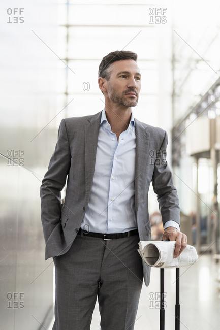 Portrait of confident businessman with baggage