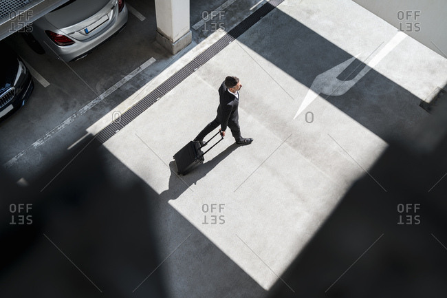 Top view of businessman with baggage on the go